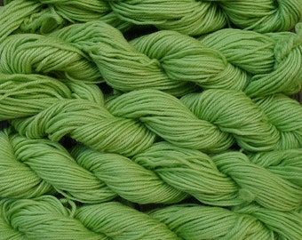 500 yards worsted weight yarn, apple green,  5 skeins, 9 oz.