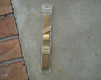 1960s  new old stock speidel gold finish men's watch band retail for 18.95 back in the day