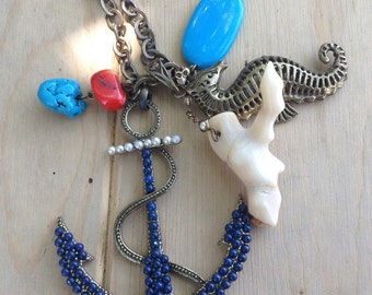 Super cute long charm necklace. Ocean themed