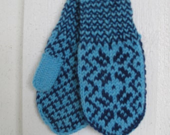 Handknitted norwegian mittens for children in light blue and blue