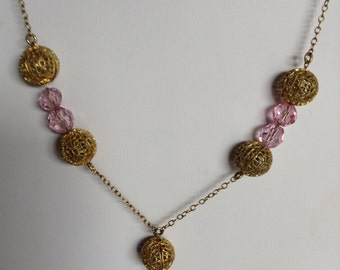 """1930's, 17 1/2"""" long, necklace of pink crystal and gold f"""