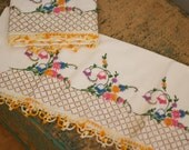 pair of vintage embroidered crocheted pillow cases