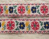 "Vintage Floral Ribbon 47"" x 1 5/8"" in width Primary colors Woven"