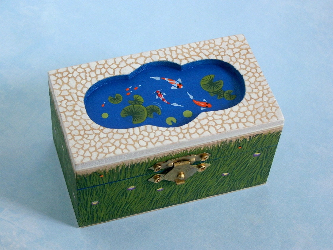 Painted wood box koi pond inset cobblestone by rockartiste for Wooden koi pool