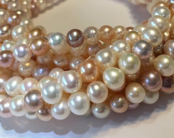 NATURAL PREMIUM Pearls near round high luster creamy mauve white and peach color WHOLE strand
