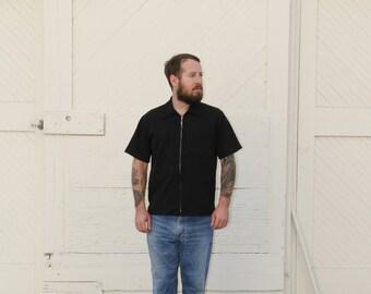 UNISEX Black zip up club shirt. M/L