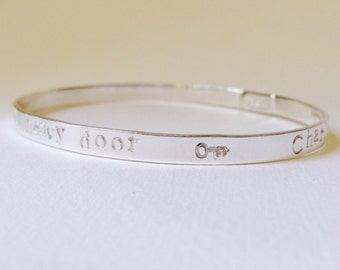 Quote bangle in silver