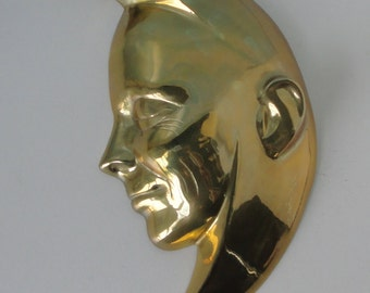 1980s  Brass Half Moon Face wall hanging.