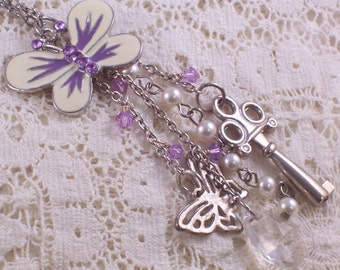 Purple and Cream Enamel Butterfly Charm Cascade Assemblage necklace by ceeceedesigns on etsy