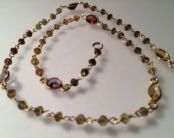 Tourmaline, gold, and various gemstone necklace