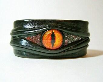 Evil eye, snake eye, dragon eye adjustable black leather bracelet cuff with snake skin. Halloween leather cuff.