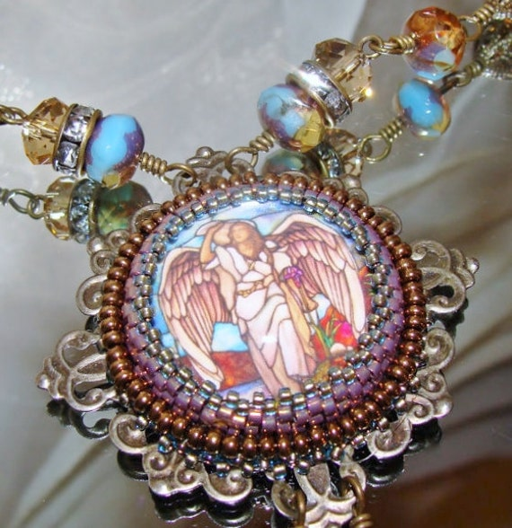 on the wings of an bead embroidery cabochon pendant