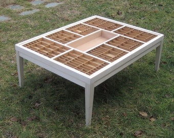 Large wood coffee table with a glass top that lifts out so you can display seashells, jewelry, and other collectibles.