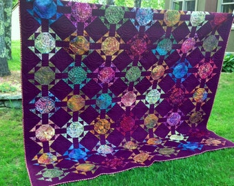 Queen modern quilt with colorful batiks