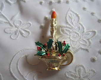 Vintage Christmas Candle in Candlestand with Orange Flame and Green Holly Leaves and Red Berries