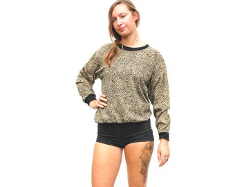 SALE!!!!!!!!! Leopard print oversize knit pullover with black trim and buttons 1990s 90s VINTAGE