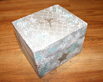 Painted and decorated wooden box with embossed dragonfly