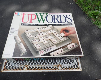 UpWords by Milton Bradley, 1988  a 3 dimensional word game spell out, stack up and score high ages 10 to adult 2- 4 players