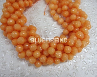 38 pcs round faceted 10mm Orange color jade beads