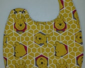 Winnie the Pooh themed Baby Bib-Waterproof with a side snap