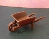 Tiny Plastic Wheelbarrow with Moving Wheel