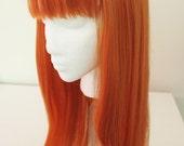 Mid Length Orange Wig