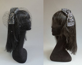 Black and silver headpiece with optional but included birdcage veil on a aliceband