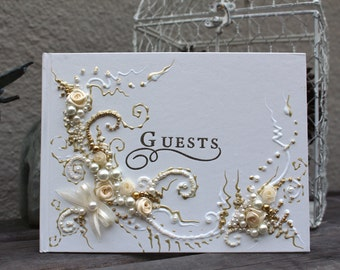 """Beautiful Wedding guest book in gold and ivory, 6""""x8.5"""" no pen or 10""""x11"""" with a pen attached, hand decorated with roses and pearls"""