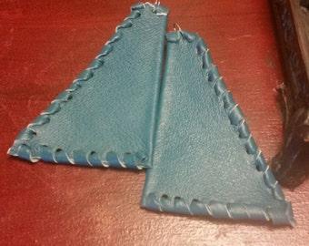 Leather geometric design earrings.
