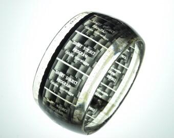 handmade resin bangle bracelet . vintage drive-in movie short subject program filmstrip . black and white eclectic geometric