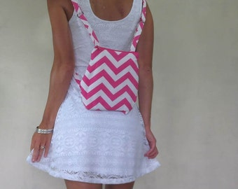 small pink chevron backpack with zipper closure and adjustable straps. Summer beach accessory.