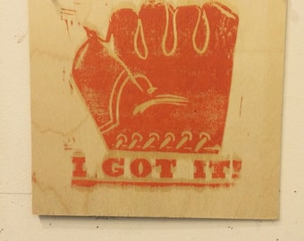 I Got It, linocut print on wood panel