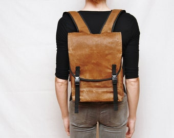 The mini, light brown small waxed canvas backpack