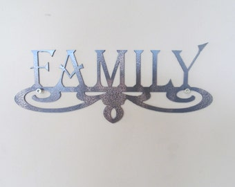 Metal sign with family and scroll