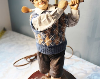 "Clothtique Golfer table Lamp on wood base 22"" high"