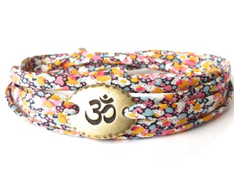 Yoga bracelet, Ohm bracelet with Liberty fabric in orange & pink, meaningful gift for best friend, UK jewellery shop