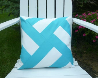 Indoor/outdoor aqua and white pinwheel pillow cover