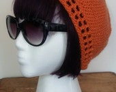 Becca Cook- Orange Crush- crochet beanie with art deco trim. Original and unique custom hat design.