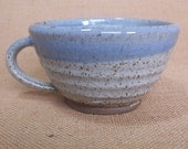 Stoneware wide coffee mug, tea cup. With speckled white glaze.