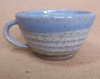 Stoneware wide coffee mug, tea cup. With speckled white glaze.
