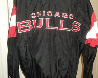 Vintage Chicago Bulls Basketball Team Black Nylon Zippered Jacket with machine Embroidered Bulls Insignia and Letters in Very Good Condition