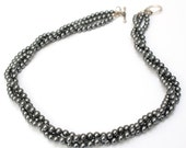 Multi Strand Necklace Made Of Three Strands Of Lustrous Dark Grey Swarovski Pearls
