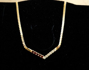 Chevron Necklace-Red simulated garnets and rhinestones on goldtone...