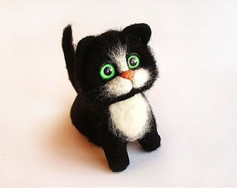 Black cat toy made of wool