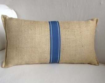 blonde burlap lumbar pillow with decorative tape in colbalt blue