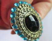 Vintage Jewelry Ladie's Ring adjustable antiqued brass toned finish aqua rhinestones no markings