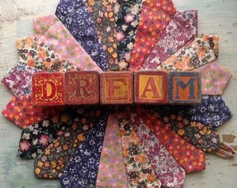 Vintage Blocks that spell out the word DREAM
