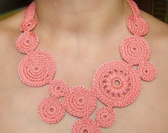 Coral pink circles crochet necklace .