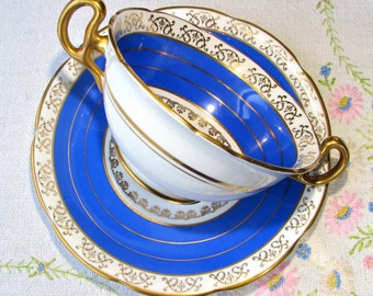 Royal Stafford blue bone china bouillon bowl and saucer with gold trim