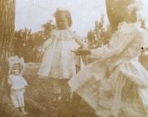 Porcelain Doll Little Girls Lacy Dresses Antique Photo